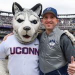 Richard Soares '97 (CLAS), '04 MBA, right, of Norwalk, with Jonathan the Husky at the New York Mets baseball game on June 3, 2018. (Peter Morenus/UConn Photo)