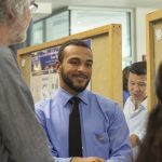 Raphael Britt, a molecular and cell biology major in the College of Liberal Arts and Sciences, speaks about his research at the McNair Scholars Poster Session on July 25, 2018. (Christine Buckley/UConn Photo)