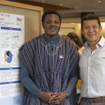 Richmond Apore '19 (CLAS), a biological sciences major, with research mentor Alfredo Angeles-Boza, assistant professor of chemistry, at the McNair Scholars Poster Session on July 25, 2018. (Christine Buckley/UConn Photo)