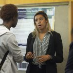 Sarah Beckett Cleveland '19 (CLAS), a biological sciences major, speaks about her research at the McNair Scholars Poster Session on July 25, 2018. (Christine Buckley/UConn Photo)