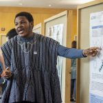 Richmond Apore '19 (CLAS), a biological sciences major, speaks about his research at the McNair Scholars Poster Session on July 25, 2018. (Christine Buckley/UConn Photo)
