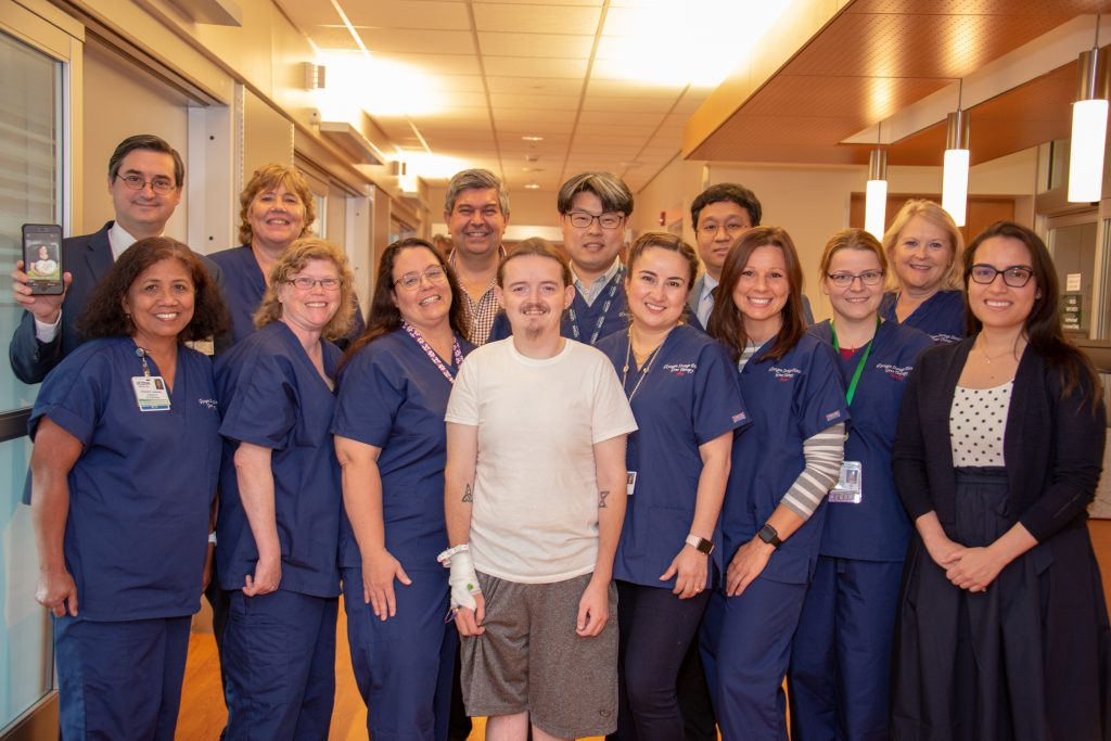 Dr. David Weinstein, back row left, with the team that administered the first-of-its-kind gene therapy to GSD patient Jerrod, front row center, at UConn John Dempsey Hospital. (Tina Encarnacion/UConn Health Photo)
