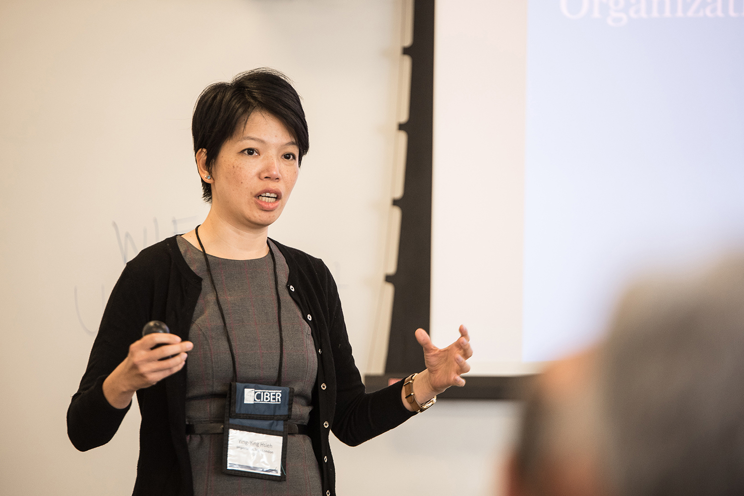 Ying-Ying Hsieh, a professor at Imperial College London, explains her research on reconceptualizing organizational governance at UConn's Blockchain Technology & Organizations Research Symposium on Aug. 14 in Stamford. The event drew two dozen faculty and researchers from around the globe. (Nathan Oldham/UConn photo)