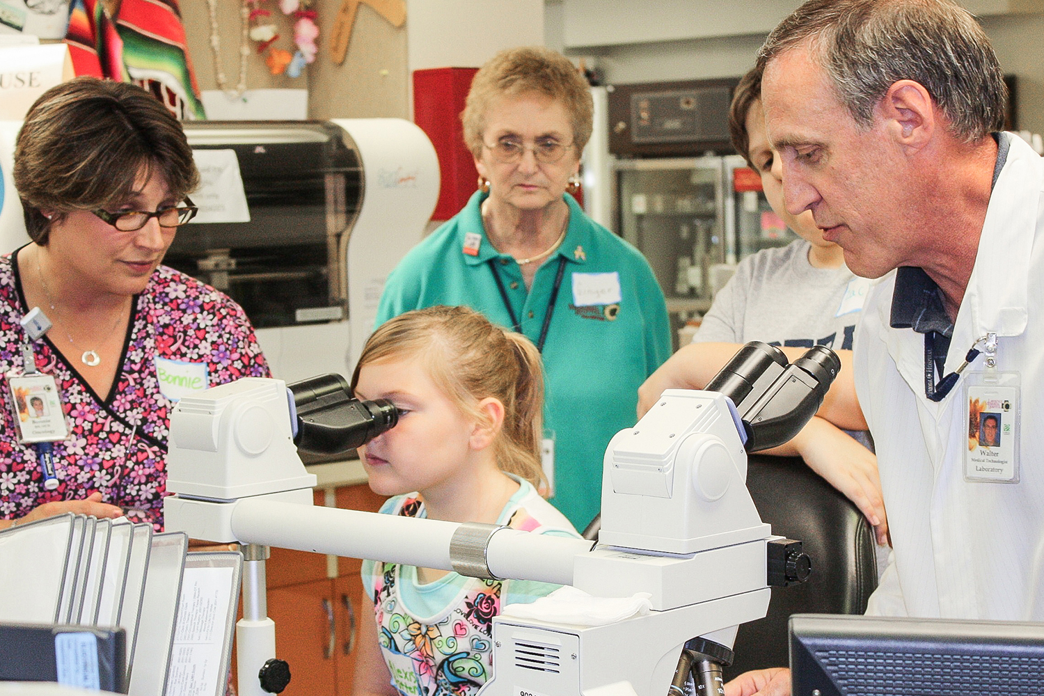 """A participant gets """"a close up look at cancer"""" in the program at Lawrence Memorial Hospital Oncology in Lawrence, Kansas. (Peter R. van Dernoot)"""