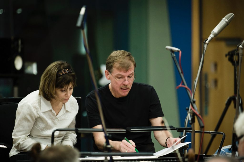 Kenneth Fuchs confers with conductor Joanne Falletta during a recording session with the London Symphony Orchestra in the Abbey Road Studios.