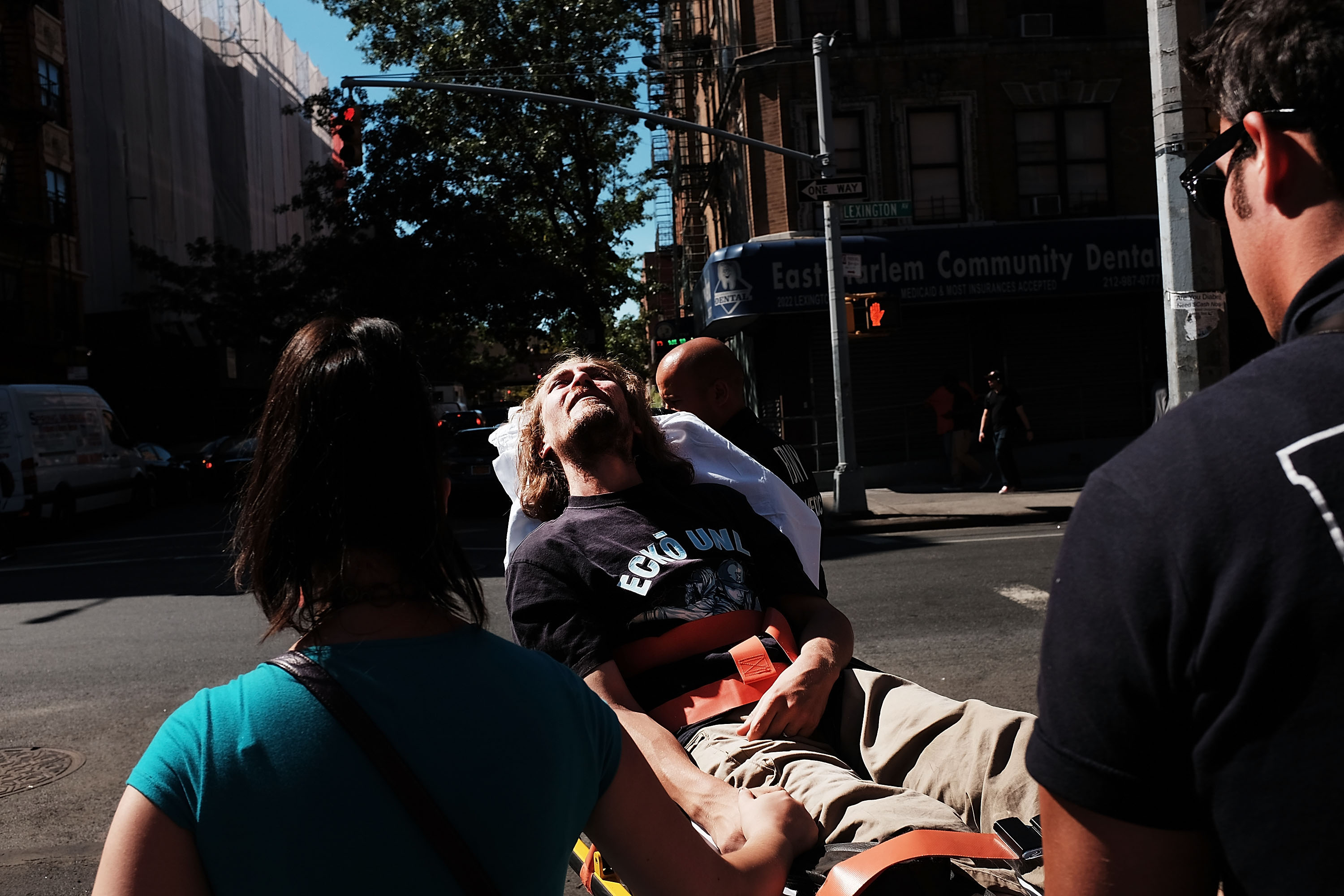 A man is consoled as paramedics take him to the hospital for what is thought to be an overdose of K2 or 'Spice,' a synthetic marijuana drug (Photo by Spencer Platt/Getty Images)