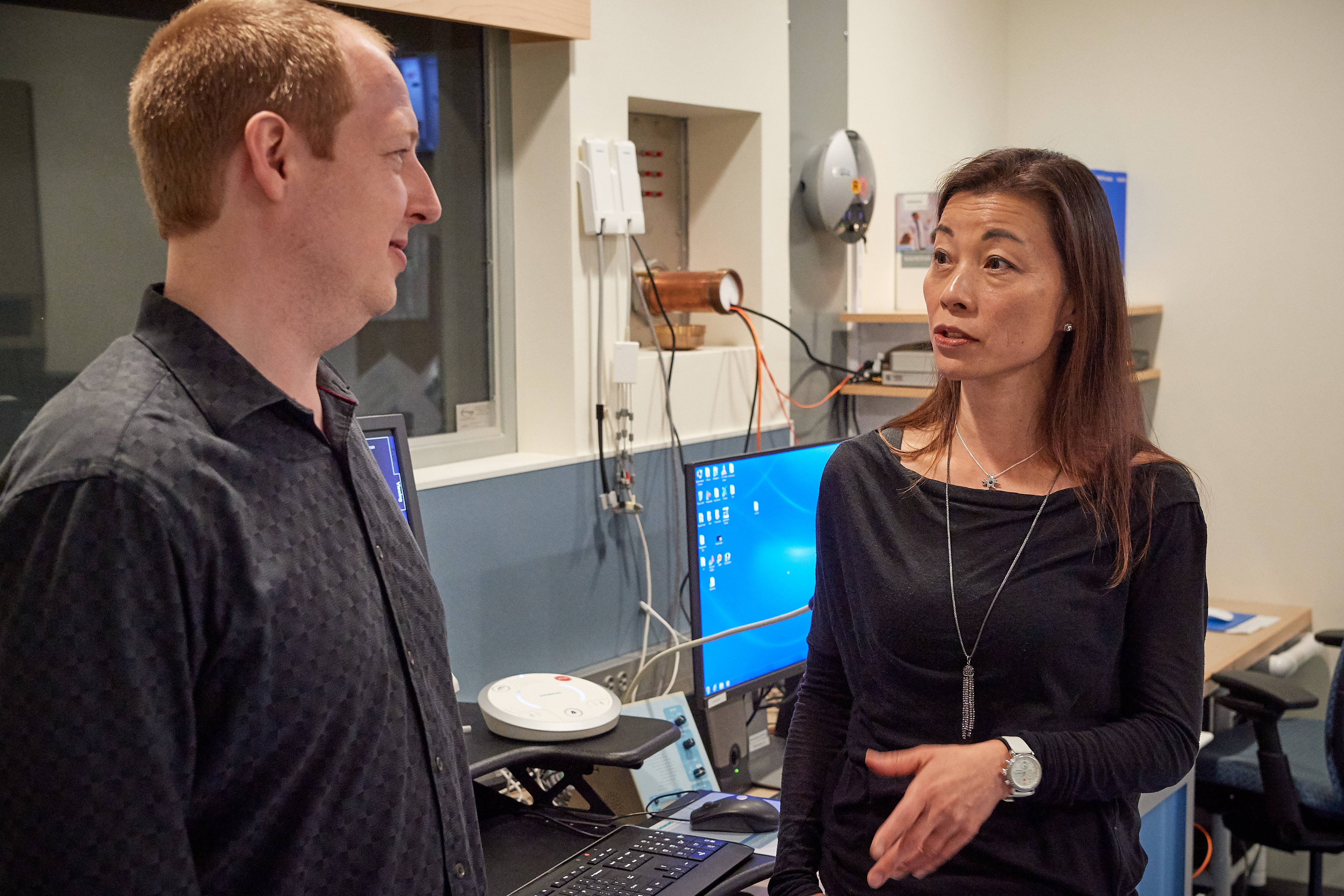Fumiko Hoeft speaks with Roeland Hancock at the Brain Imaging Resource Center on Aug. 1, 2018. (Peter Morenus/UConn Photo)