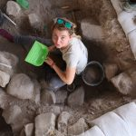 UConn graduate student Roxanne Lebenzon excavating at Nahal Ein Gev II, a 12,000 year-old archaeological site in northern Israel, east of the Sea of Galilee. (Photo by Laura Dubreuil)