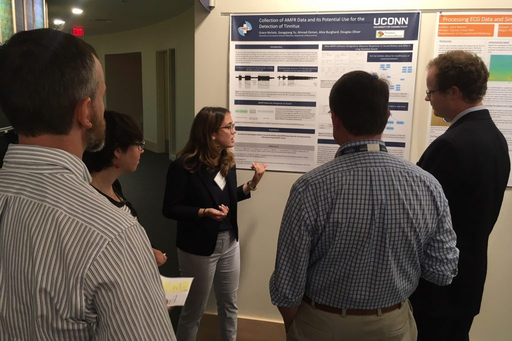 PIE Fellow Grace Nichols, a molecular and cell biology major at UConn, presents her research at the poster session. Her faculty mentor is Douglas Oliver in Department of Neuroscience at UConn Health. (Lauren Woods/UConn Health Photo)