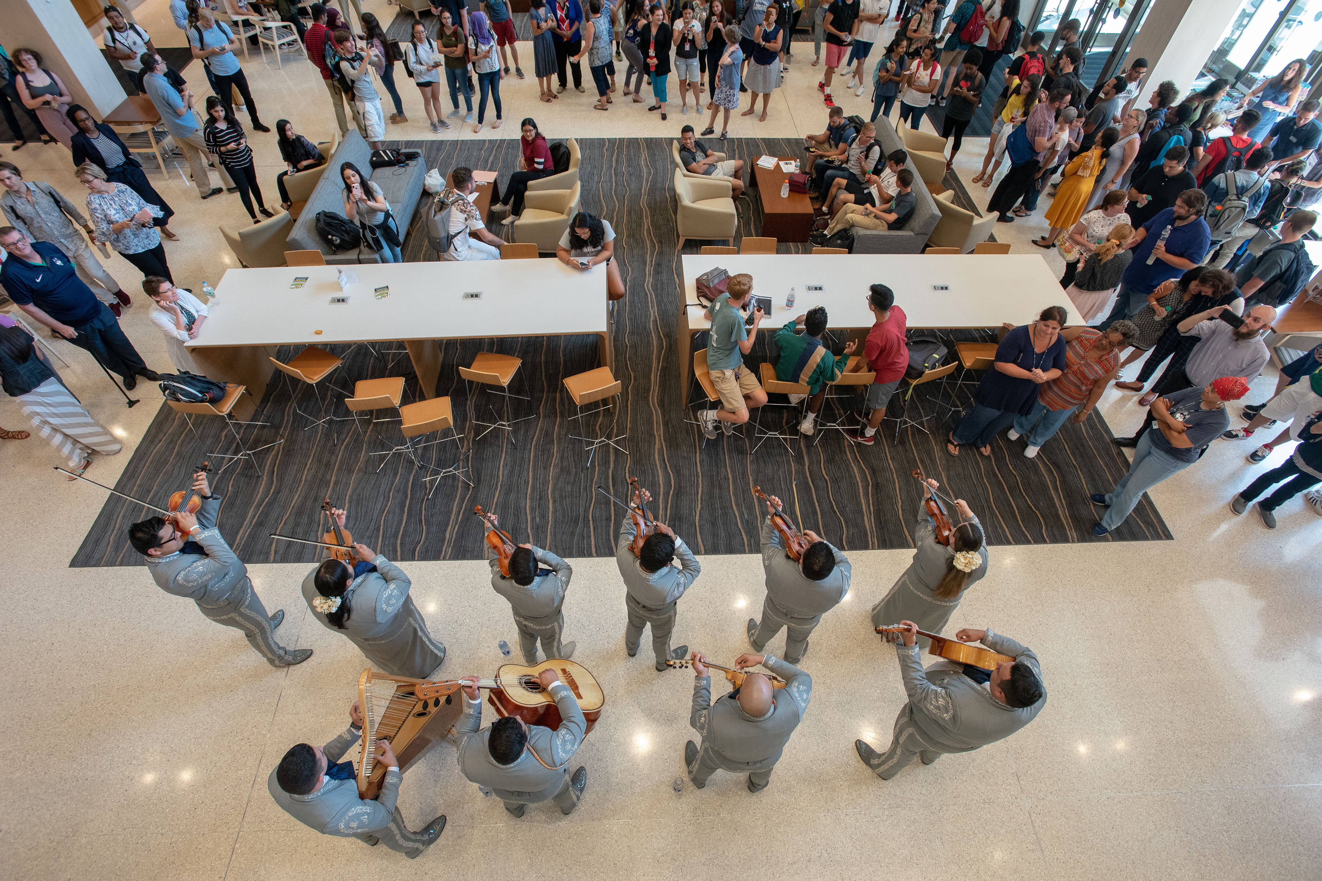 Students, faculty, and staff listen to the Mariachi Mexico Antiguo Band during the Hartford Campus Convocation Celebration in Mortensen Courtyard (atrium) on Aug. 29, 2018. (Sean Flynn/UConn Photo)