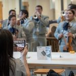 Students take photos of the Mariachi Mexico Antiguo Band during the Hartford Campus Convocation. (Sean Flynn/UConn Photo)