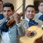 Erick Castro, left, and Rodbel Virula of the Mariachi Mexico Antiguo Band play to a full crowd at the Hartford Campus on Aug. 29, 2018. (Sean Flynn/UConn Photo)