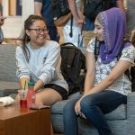 April Saynganthone '21 (CLAS), left, and Lubna Rauf '21 (CLAS) chat during the Hartford Campus Convocation celebration in the Zachs Atrium on Aug. 29, 2018. (Sean Flynn/UConn Photo)