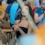 Freshman Melisa Rivera '22 (CLAS) enjoys the celebration that welcomed new students to the Hartford Campus. (Sean Flynn/UConn Photo)