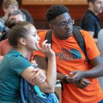 Freshmen Sarah Canseco '22 (CLAS) and Kevon Gayle '22 (CLAS) enjoy the Hartford Campus celebration that welcomed new students. (Sean Flynn/UConn Photo)
