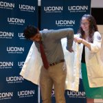 On Aug. 24, the entering class at the School of Medicine received their white coats during the annual White Coat Ceremony. The white coat has become a symbol of the science and art of medicine. The Class of 2022 is the School's 50th class, and also its largest at 106 students. (Tina Encarnacion/UConn Health Photo)