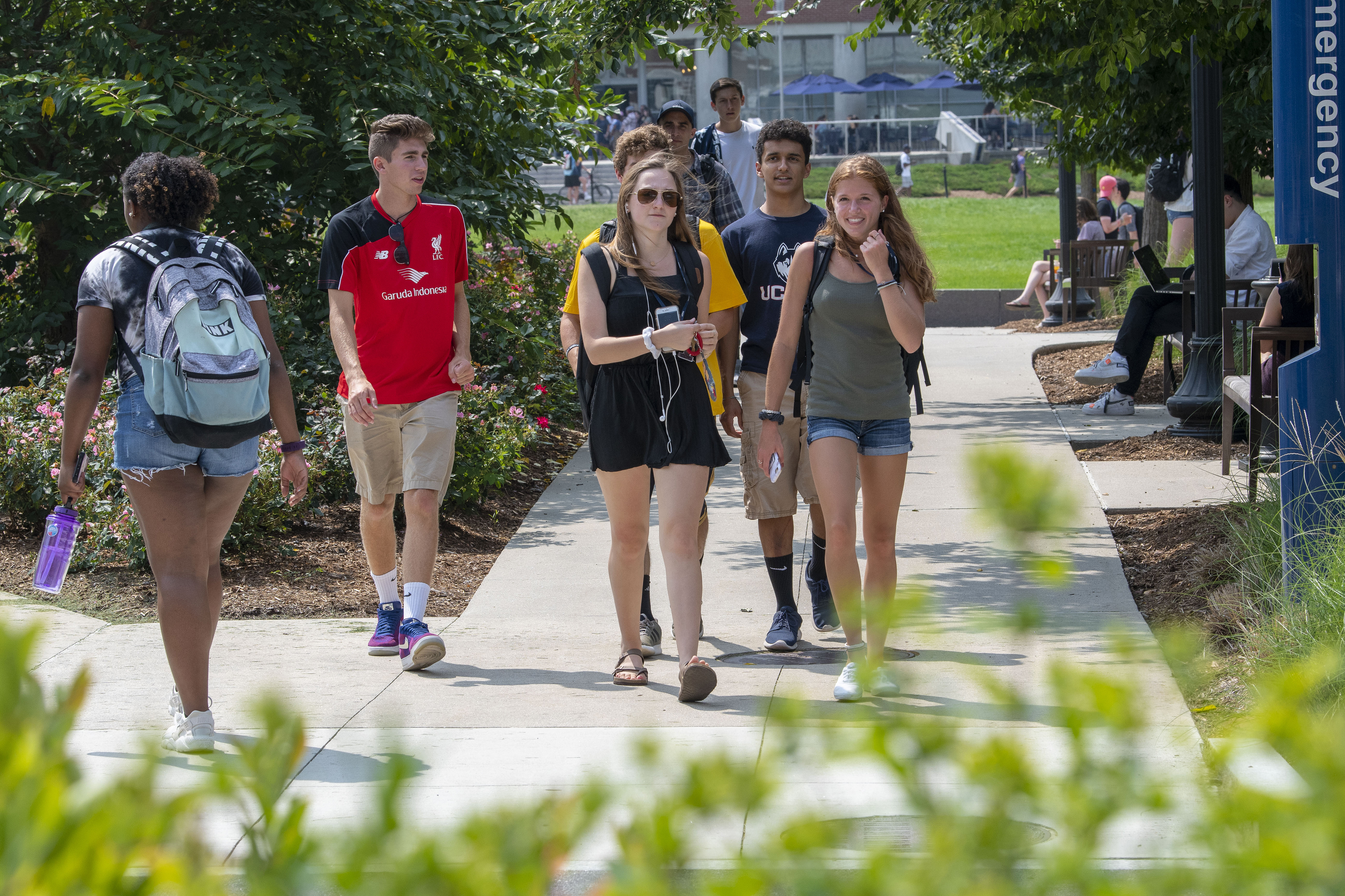 Students walking on campus on Aug. 27, 2018. (Sean Flynn/UConn Photo)