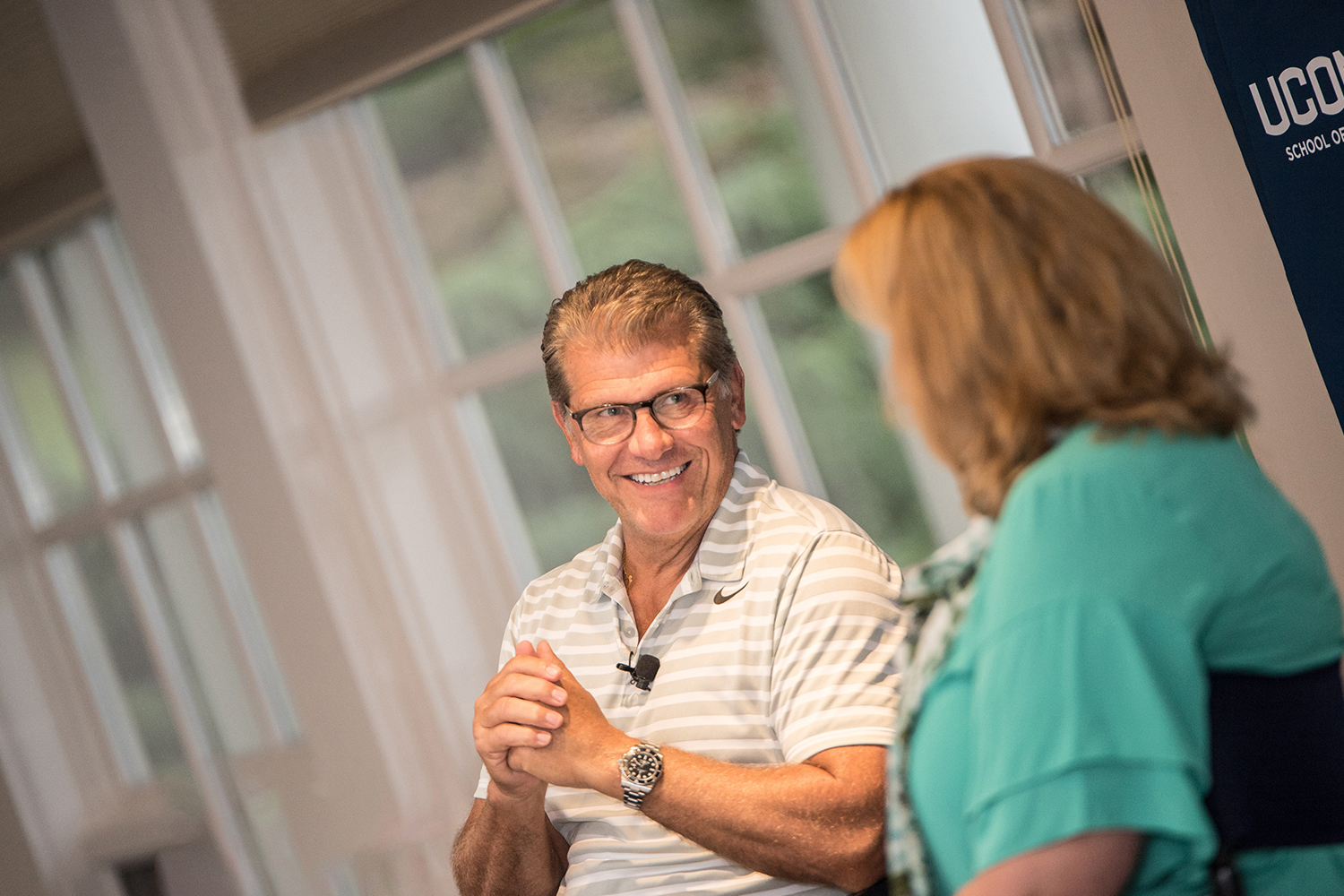Geno Auriemma, head coach of the UConn Women's Basketball program, shared stories of basketball, leadership and success with the new cohort of the Executive MBA program on Thursday. Lucy Gilson, head of the management department, served as event moderator. (Nathan Oldham/UConn School of Business)