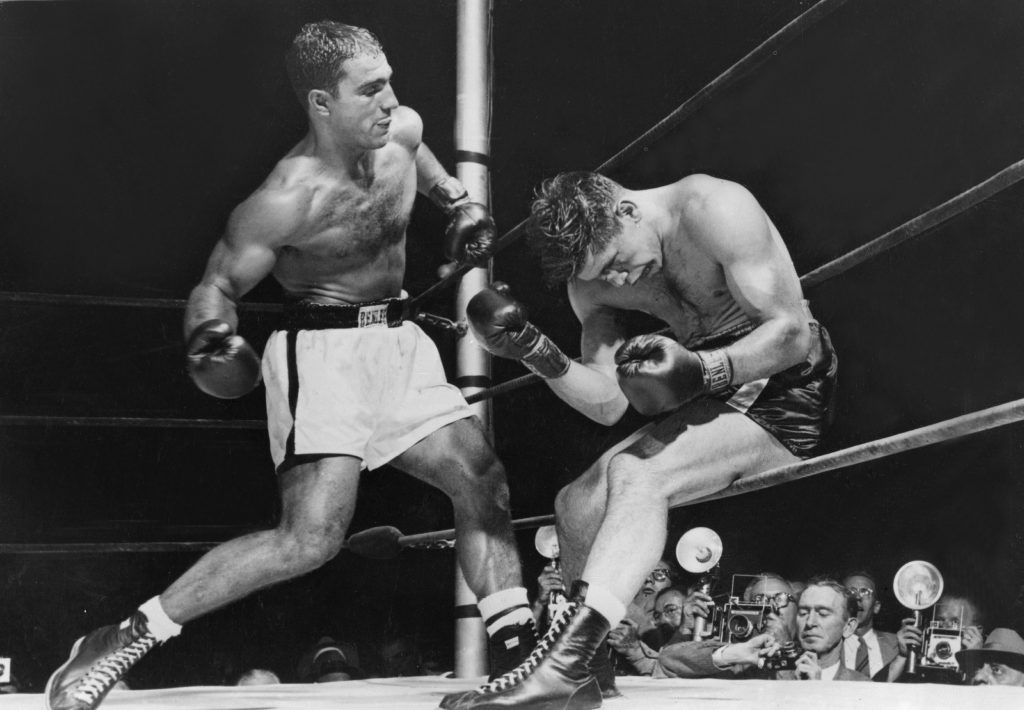 American boxer Rocky Marciano, left, beat Roland La Starza to retain the world heavyweight title in 1953. (Keystone/Getty Images)