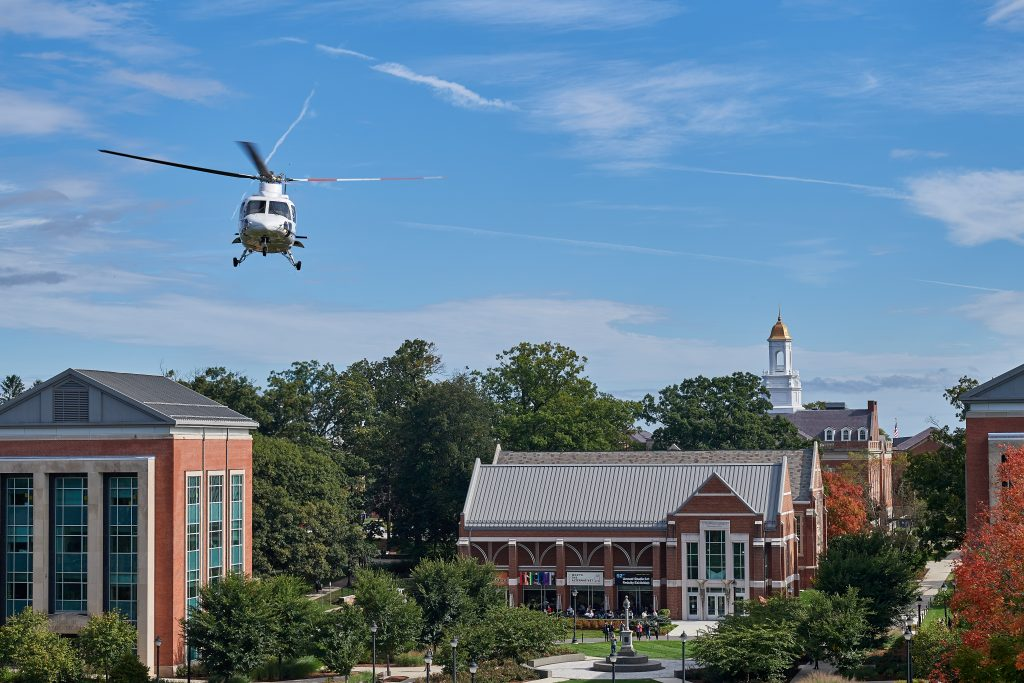 A group of students, faculty and staff take off for a ride in a Sikorsky S-76 helicopter from the Student Union Mall as part of Lockheed Martin Day on Sept. 27, 2018. (Peter Morenus/UConn Photo)