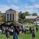 Students, faculty and staff check out Sikorsky Black Hawk, left, and S-76 helicopters on the Student Union Mall as part of Lockheed Martin Day on Sept. 27, 2018. (Peter Morenus/UConn Photo)