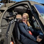 Cara Workman '95 (CLAS), '17 MBA sits at the controls of a Sikorsky Black Hawk helicopter on the Student Union Mall during Lockheed Martin Day on Sept. 27, 2018. (Peter Morenus/UConn Photo)
