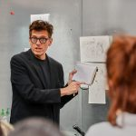 Illustrator Dwayne Booth, aka Mr. Fish, critiques draft illustrations during the class. (Peter Morenus/UConn Photo)