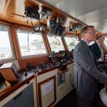 Provost Craig Kennedy and Robin Cote, associate dean of physical sciences in CLAS, check out the bridge of the R/V Connecticut after the recommissioning ceremony at the Avery Point campus on Sept. 13, 2018. (Peter Morenus/UConn Photo)
