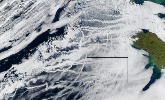 Ship tracks form when very small, airborne particles emitted in the exhaust of large ships (and airplanes) attract water molecules, acting as 'seeds' (or 'cloud condensation nuclei') for clouds. Continued accumulation of droplets on the cloud condensation nuclei forms the thin, streaky clouds pictured in this image. (NASA Photo)