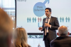 Engineering doctoral student Reza Amin presents the QRFertile concept to a panel of judges during the Wolff New Venture Competition. (Eric Olson for UConn)