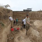 Researchers and Armenian workers at work excavating the site.