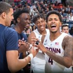 From left Kwintin Williams and Sidney Wilson of the Blue Team share a joke with Brendan Adams and Jalen Adams (no relation) of the White Team. (Stephen Slade '89 (SFA) for UConn)