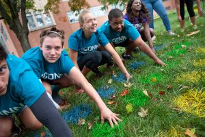Members of Public Health House wait for the next command while playing Lawn Twister. (Defining Studios Photography for UConn)