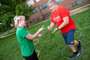 A member of Business Connections House (left) plays Hula Hoop, Rock, Paper, Scissors with a member of Eurotech House. (Defining Studios Photography for UConn)