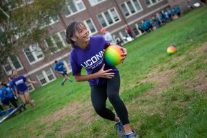 Kate Bruder, a member of Women in Math, Science, and Engineering (WiMSE) House, participates in a dodgeball competition. (Defining Studios Photography for UConn)