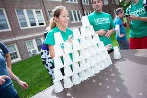 Business Connections House students strategize to build a pyramid of paper cups and return them to one pile in 60 seconds or less. (Defining Studios Photography for UConn)