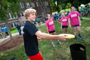 A member of Connecting with the Arts House prepares to throw a flying disc in the Kan Jam competition. (Defining Studios Photography for UConn)