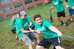 Members of Business Connections House, including house president Zach Solomon (front), engage in a tug'o'war. (Defining Studios Photography for UConn)