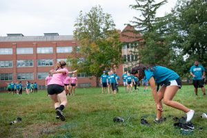 Members of Fine Arts House (wearing pink) and Public Health House (in blue) play Sneaker Scramble. (Defining Studios Photography for UConn)