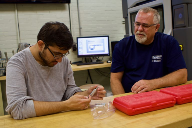 Mark Bouley, right, sits with a UConn Engineering student during safety classes. (UConn Photo/Christopher Larosa)