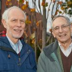 Greg Anderson, Distinguished Professor Emeritus of Ecology and Evolutionary Biology, left, and Richard Brown, Distinguished Professor Emeritus of History, at the ceremonial planting of the Class of 2019 tree near the William H. Hall Building on Oct. 23, 2018. (Peter Morenus/UConn Photo)