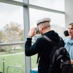 UConn's first Entrepreneurship Expo, held on Oct. 29, was designed to let students know about the numerous opportunities for innovation offered across campus. Here, a student wearing a virtual reality headset watches live drone footage from a pilot flying a drone outside on the Student Union Mall. (Nathan Oldham/UConn Photo)