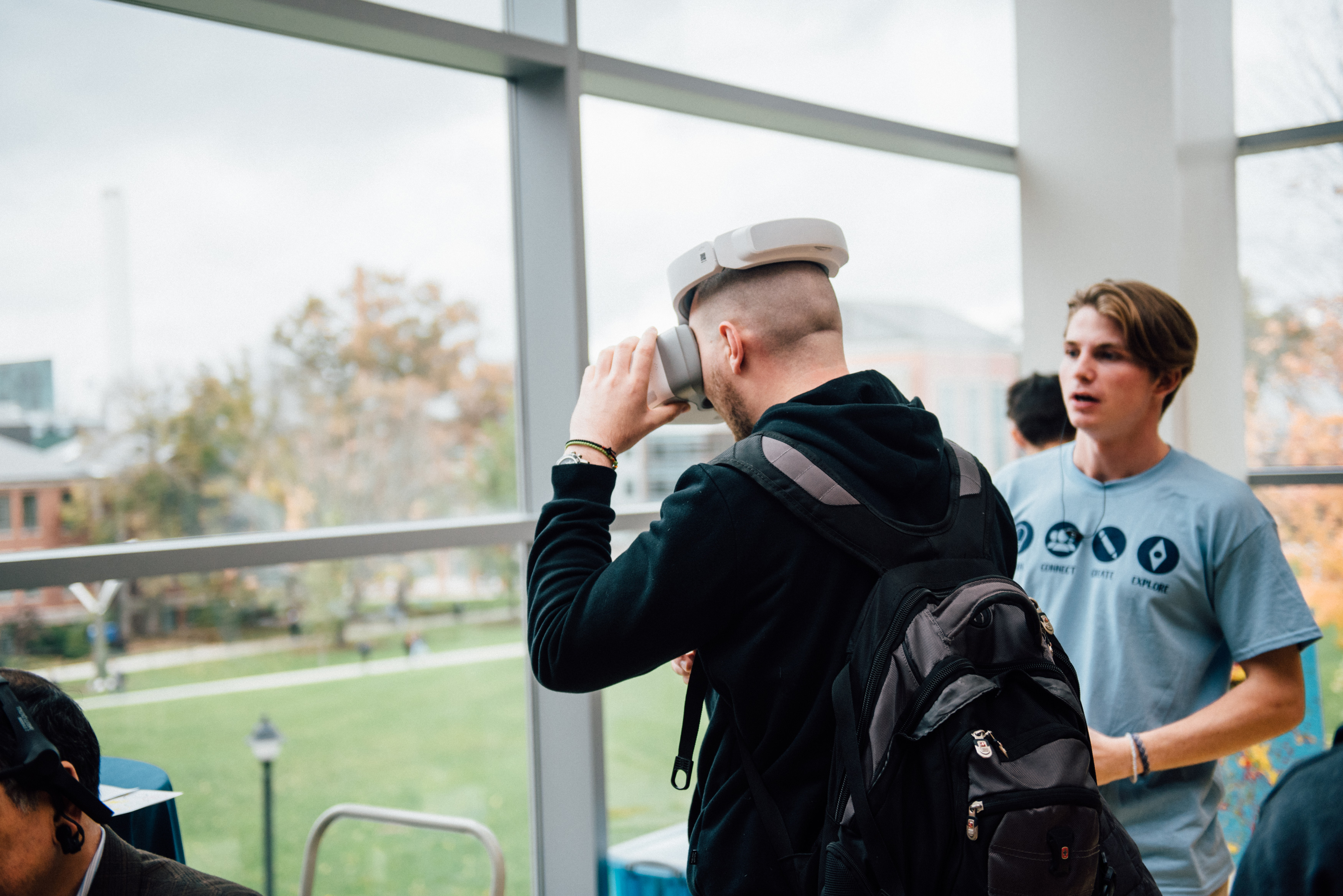 A student wearing a virtual reality headset watches live drone footage from a pilot flying a drone outside the Student Union during the Innovation Expo on Oct. 29. (Nathan Oldham/UConn Photo)