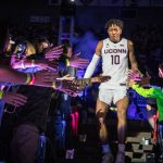 Freshman Brendan Adams greets fans as he makes his entrance at First Night. (Jason Reider/UConn Athletics Photo)