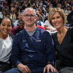 Men's Basketball head coach Dan Hurley (center) with Jasmine Lister, Women's Basketball assistant coach (left) and Chris Dailey, Women's Basketball associate head coach, coached the winning Blue Team during the mixed teams competitions at First Night. (Stephen Slade '89 (SFA) for UConn)
