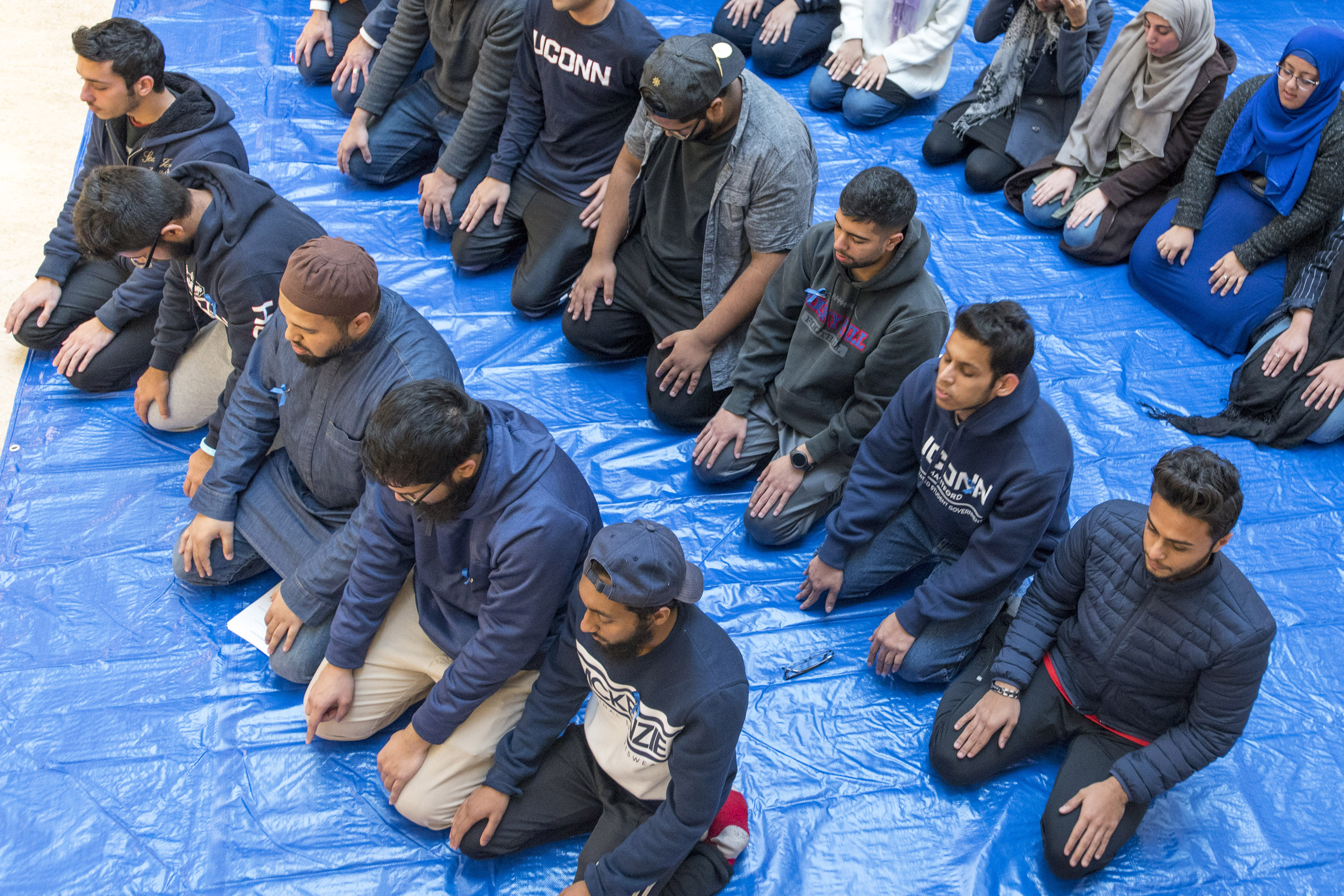 A Muslim prayer service at the Hartford Public Library before a Metanoia event at the Hartford Campus in November 2017. (Sean Flynn/UConn File Photo)