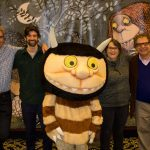 From left, Sendak Foundation Fellows Stephen Savage and Doug Salati are joined by curator Jonathan Weinberg, director Lynn Caponera, and a costumed character Wild Thing for a photo in front of a mural from Maurice Sendak's world-famous book 'Where the Wild Things Are.' (Lucas Voghell '20 (CLAS)/UConn Photo)