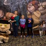 A last group photo to conclude the day, with kids and parents posing in front of the Wild Things mural. (Lucas Voghell '20 (CLAS)/UConn Photo)