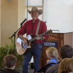 Author, illustrator, and country singer Grant Maloy Smith entertains the crowd with songs after a drawing presentation. (Lucas Voghell '20 (CLAS)/UConn Photo)