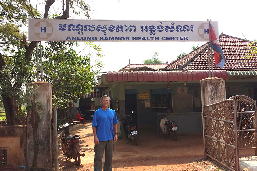 Thomas Buckley, UConn associate clinical professor of pharmacy practice, one of several UConn researchers working with survivors of the Khmer Rouge, at a rural village health clinic in Cambodia during a sabbatical leave. (Courtesy of Tom Buckley)